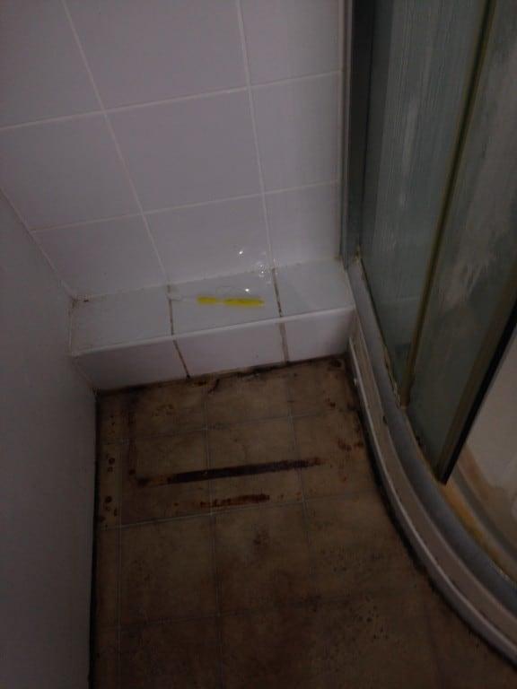 bathroom floor before cleaning